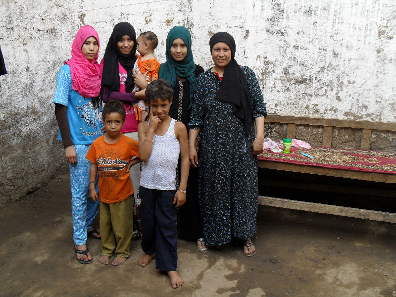 A widow who has 8 children to care for.