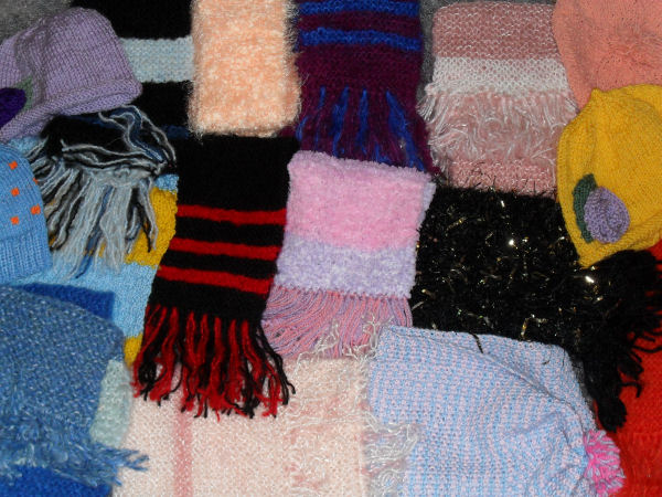 Scarves and hats knitted by our supporters